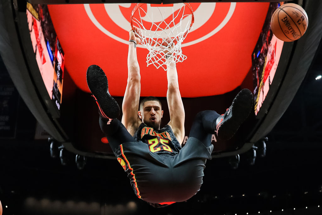 Alex Len of the Atlanta Hawks dunks the ball