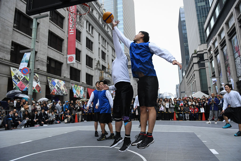 Athletes demonstrates their 3x3 basketball skills during the Tokyo 2020 Olympic 1,000 Days Countdown event