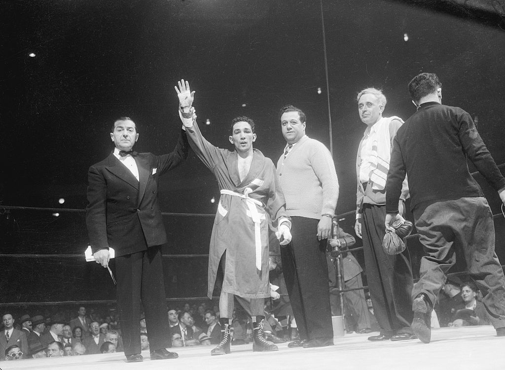Boxer Willie Pep wins a fight in 1900
