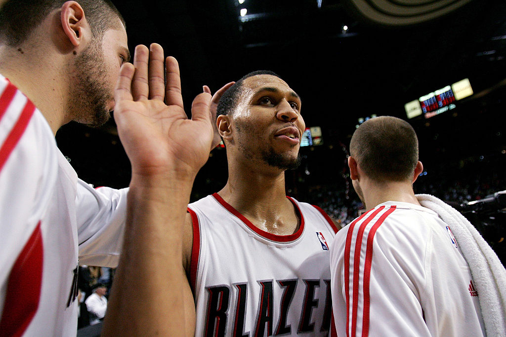 Brandon Roy of the Portland Trail Blazers high fives his teammates in 2007