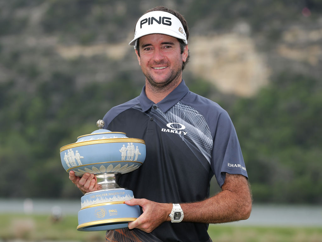 Bubba Watson holding the trophy from the World Golf Championship