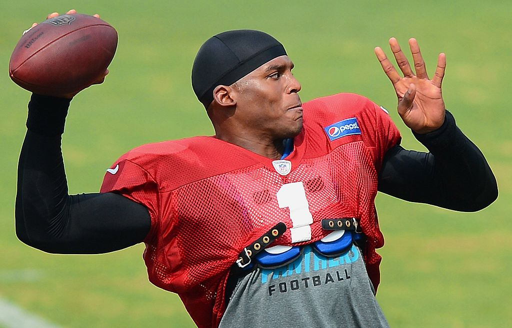 Cam Newton throwing a ball during a practice