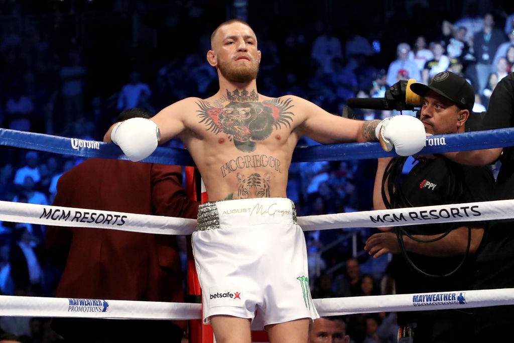 Conor McGregor standing in his corner during a boxing match
