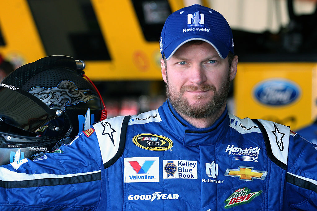 Dale Earnhardt Jr posing for a photo in his racing uniform