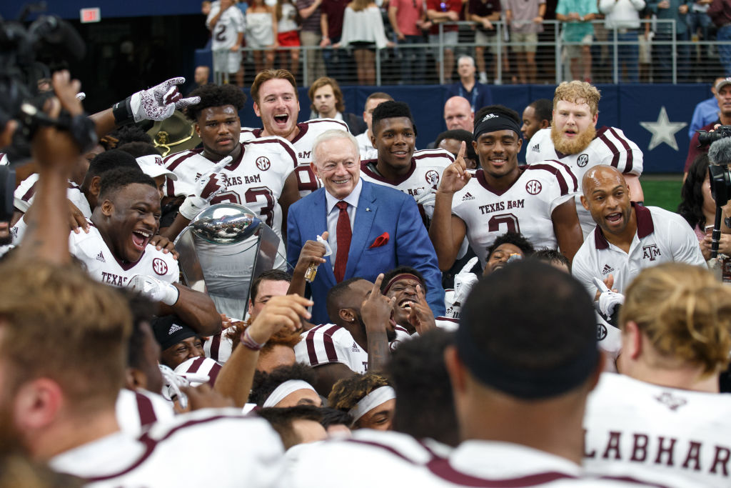 Dallas Cowboys owner Jerry Jones presents the 2017 Southwest Classic trophy to the Texas A&M Aggies
