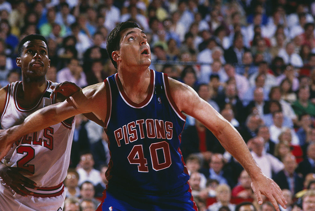 Detroit Pistons' Bill Laimbeer looks for the rebound