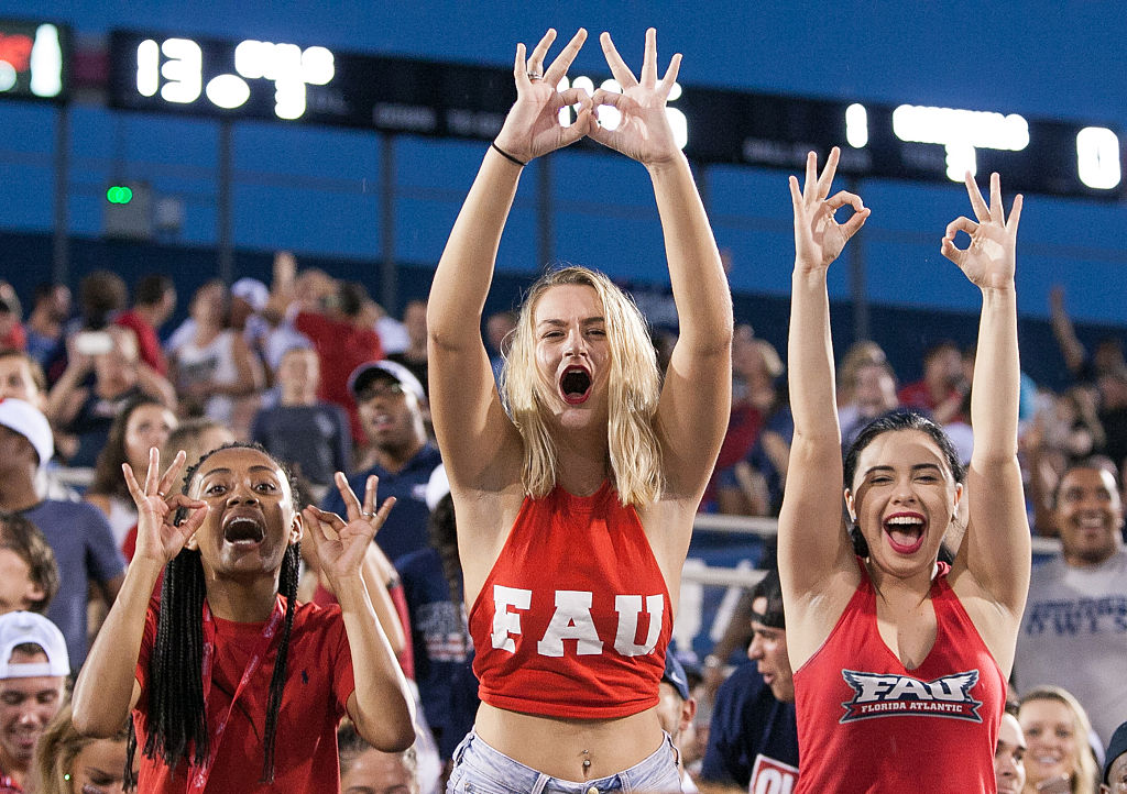 "Florida Atlantic fans cheer during a football game. New FAU head coach Willie Taggart urged fans to ""keep faith"" during the coronavirus pandemic."