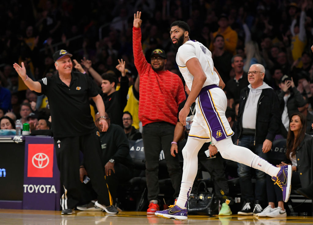 Fans celebrate after Anthony Davis of the Los Angeles Lakers scores