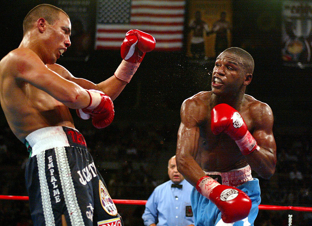 Floyd Mayweather throws a punch at Jose Luis Castillo
