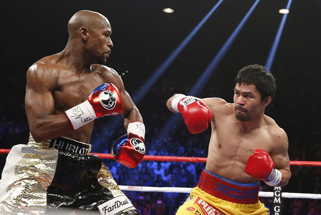 Floyd Mayweather defending punches from Manny Pacquiao