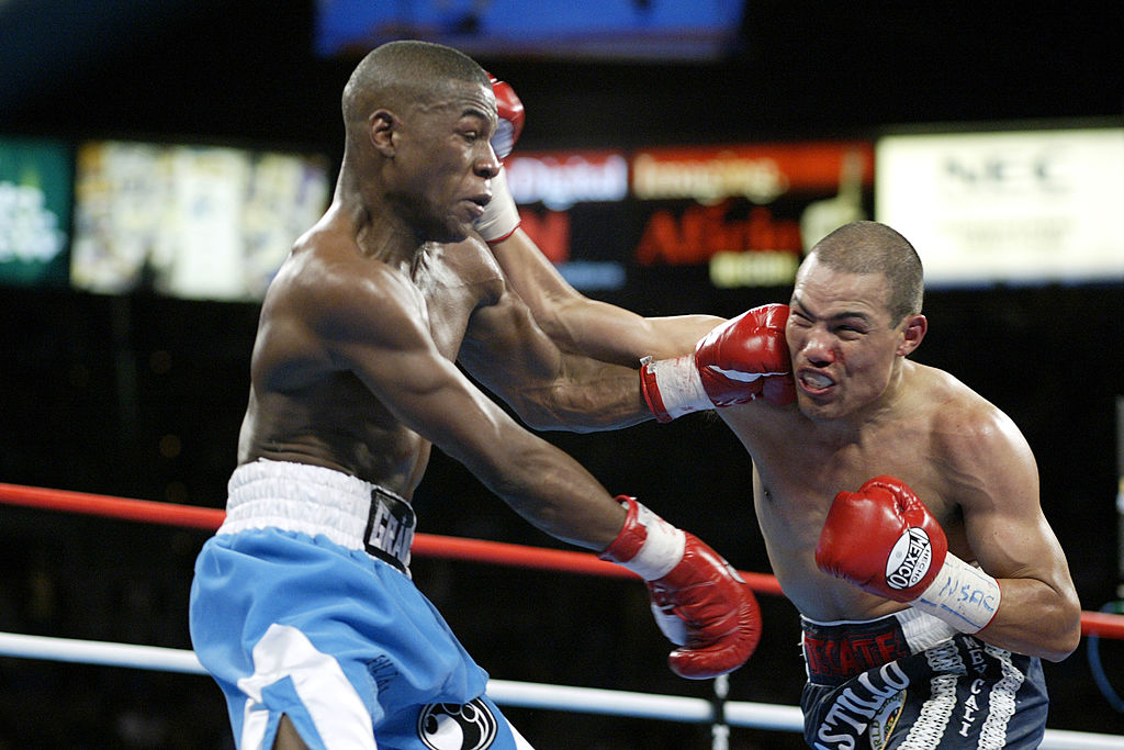 Floyd Mayweather fights Jose Luis Castillo during a boxing match