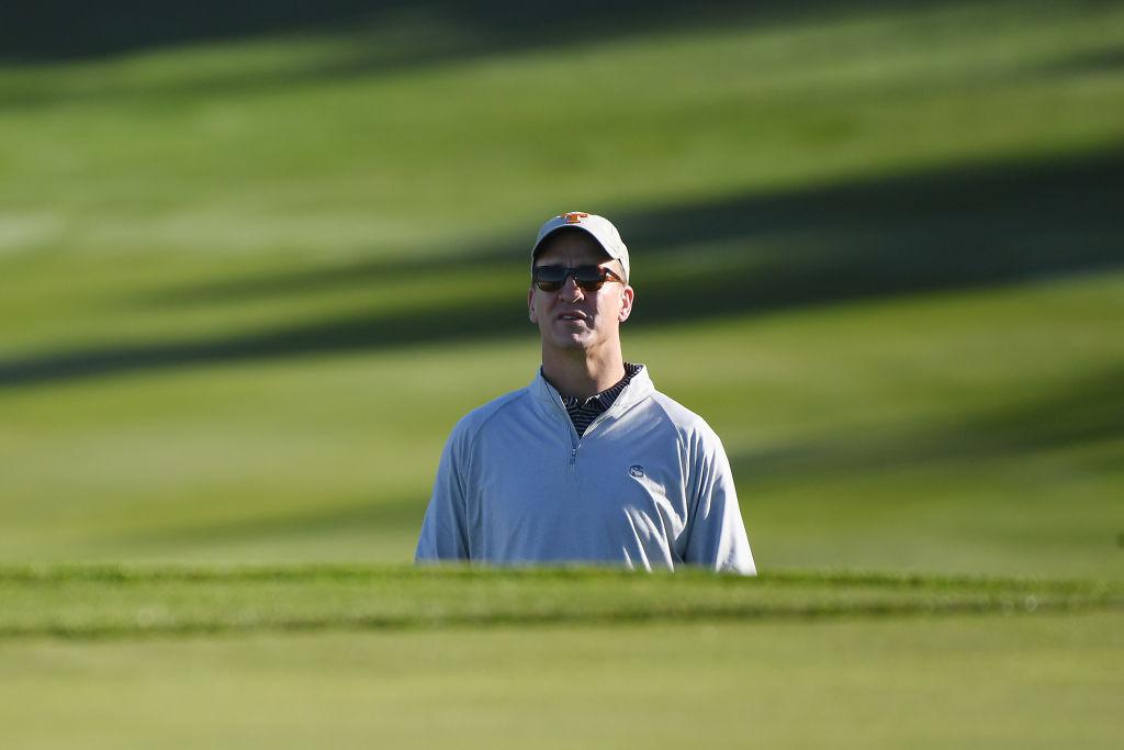 Former NFL quarterback Peyton Manning golfing in 2020