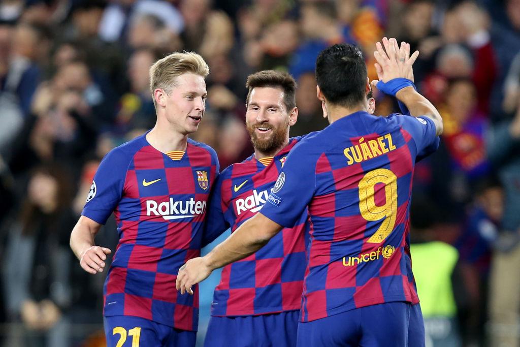 FC Barcelona's Frenkie de Jong, Lionel Messi, and Luis Suarez celebrate after scoring