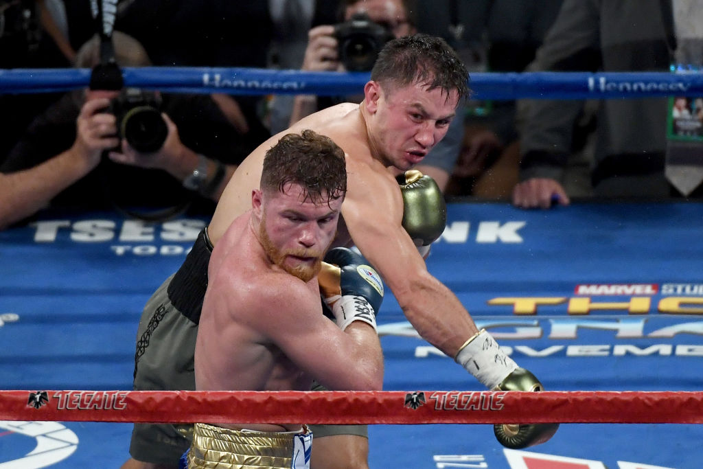 Gennady Golovkin throws a punch at Canelo Alvarez in 2017