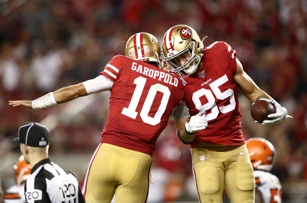 Georege Kittle and Jimmy Garoppolo celebrating after a play