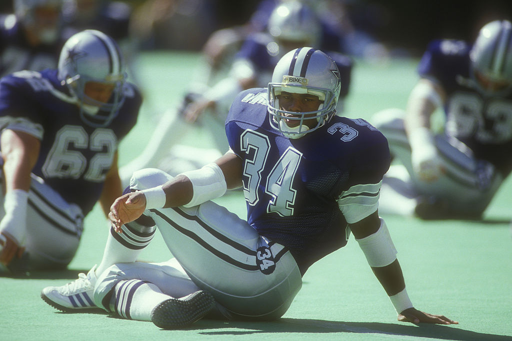 Herschel Walker of the Dallas Cowboys warms up before a football game in 1986