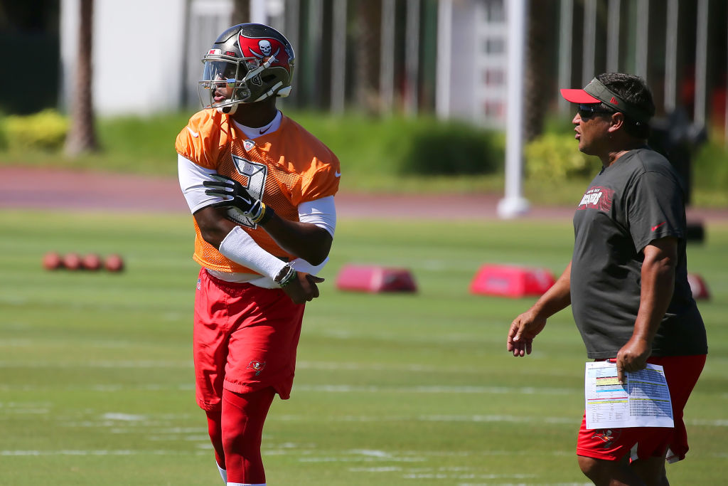 Tampa Bay Buccaneers quarterbacks coach Clyde Christensen (right) believes he failed former Buccaneeers quarterback Jameis Winston. Winston threw 30 interceptions last season.