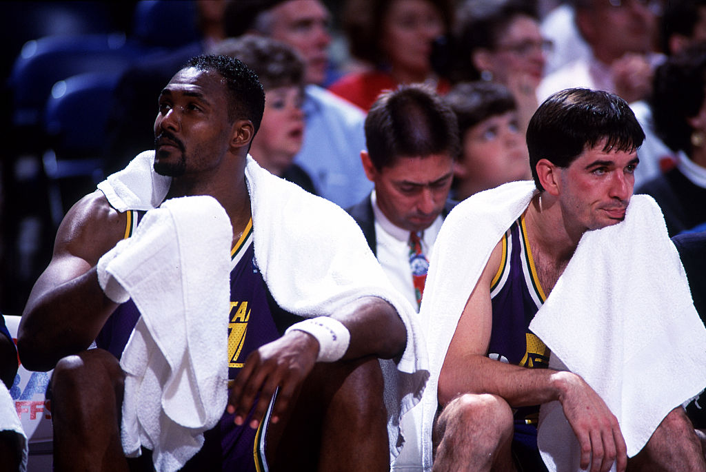 Karl Malone and John Stockton sitting on the bench