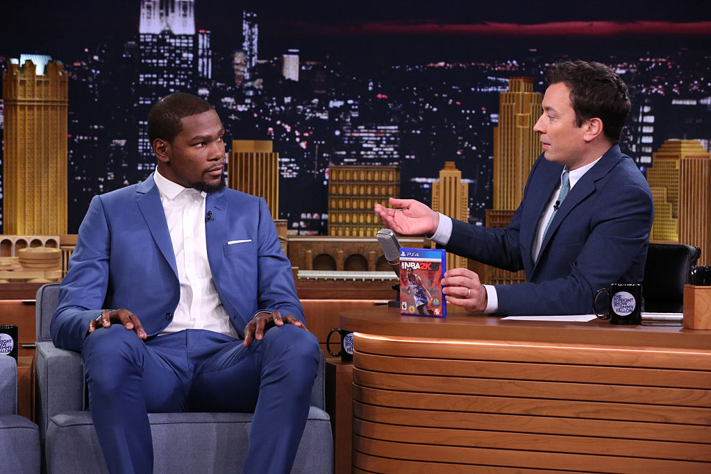 Kevin Durant sitting down for an interview with Jimmy Fallon