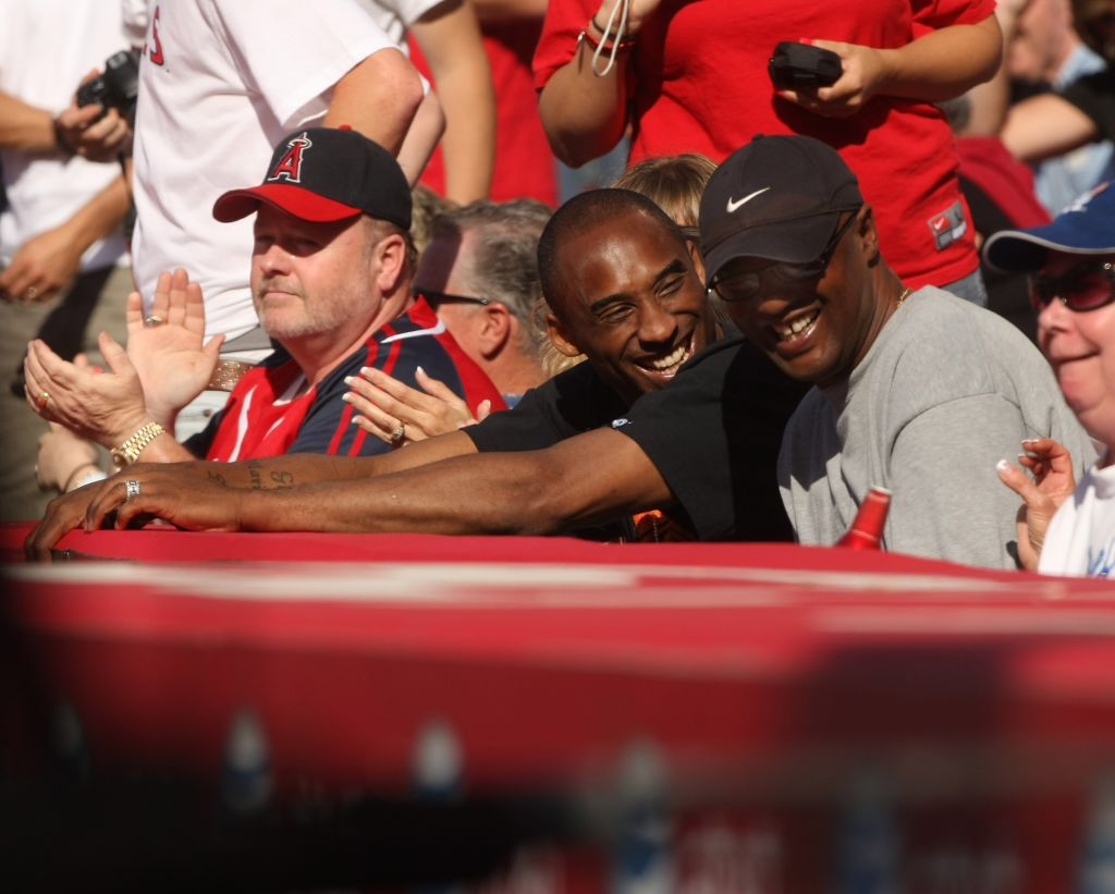 Kobe Bryant of the Los Angeles Lakers and father Joe Bryant attend an MLB game in 2009