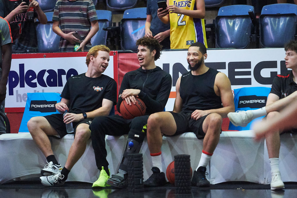 Injured LaMelo Ball of Illawarra Hawks sits on the bench in 2020