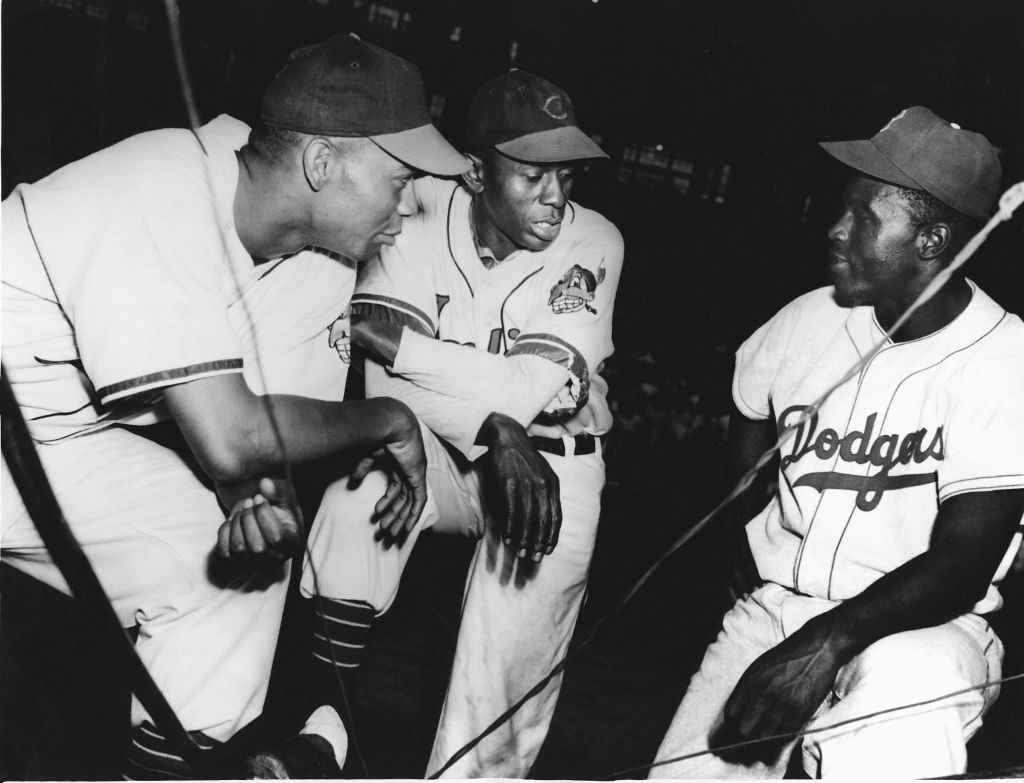 Many black baseball players thought pitcher Satchel Paige (middle) would break baseball's color barrier. They weren't pleased when Jackie Robinson, right, achieved that honor in 1947.