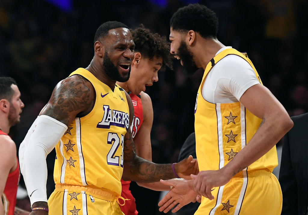 The Los Angeles Lakers' LeBron James celebrates after Anthony Davis