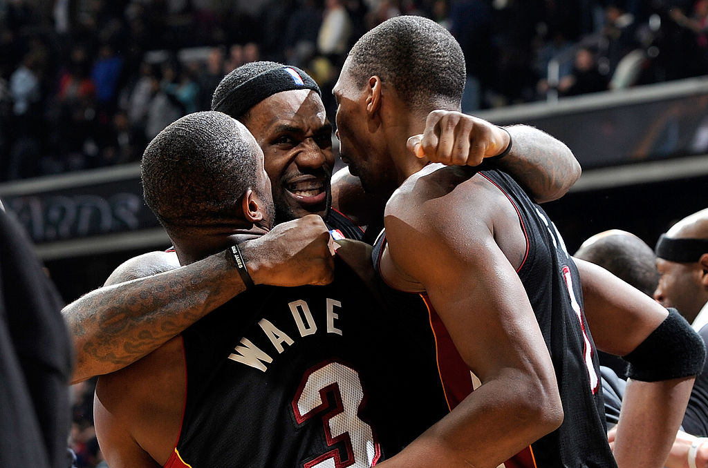 LeBron James celebrates with Dwyane Wade and Chris Bosh of the Miami Heat in 2010