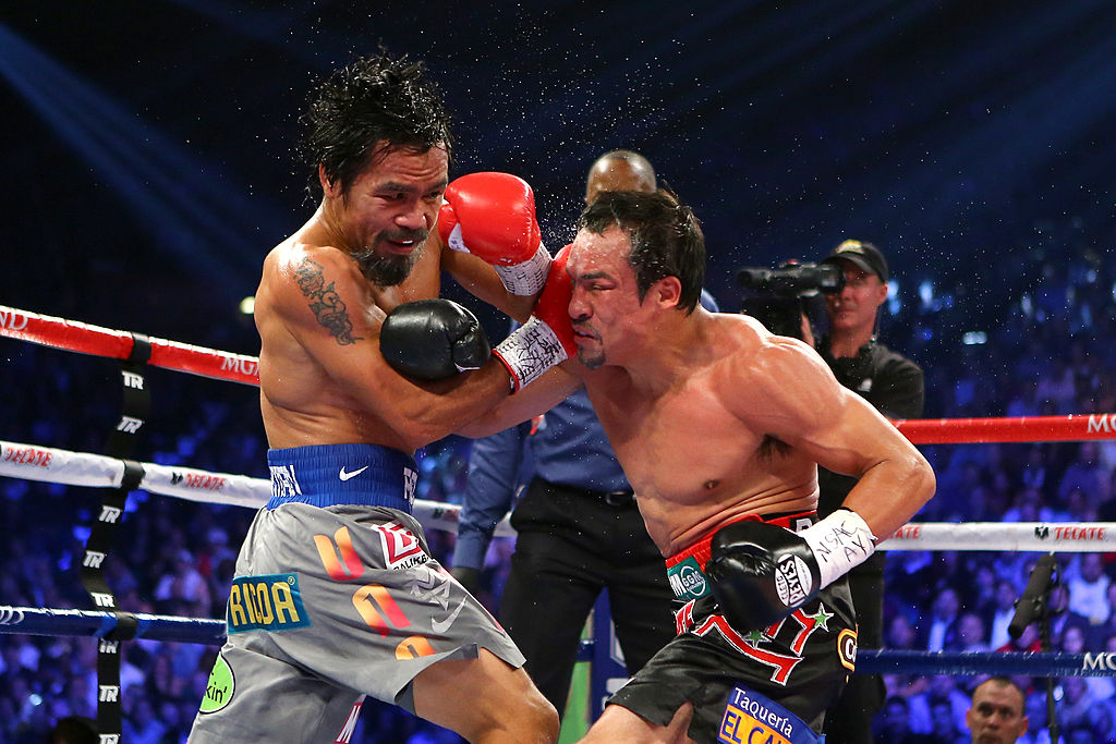 Manny Pacquiao and Juan Manuel Marquez exchange blows in 2012