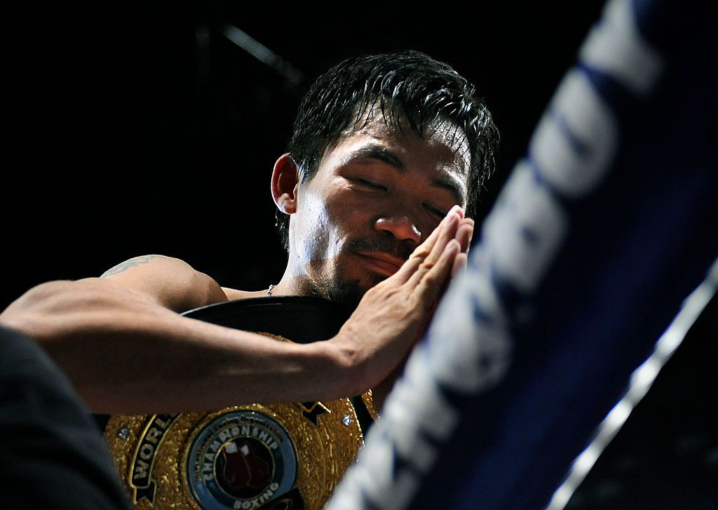Manny Pacquiao prays after his knock out of Ricky Hatton in 2009