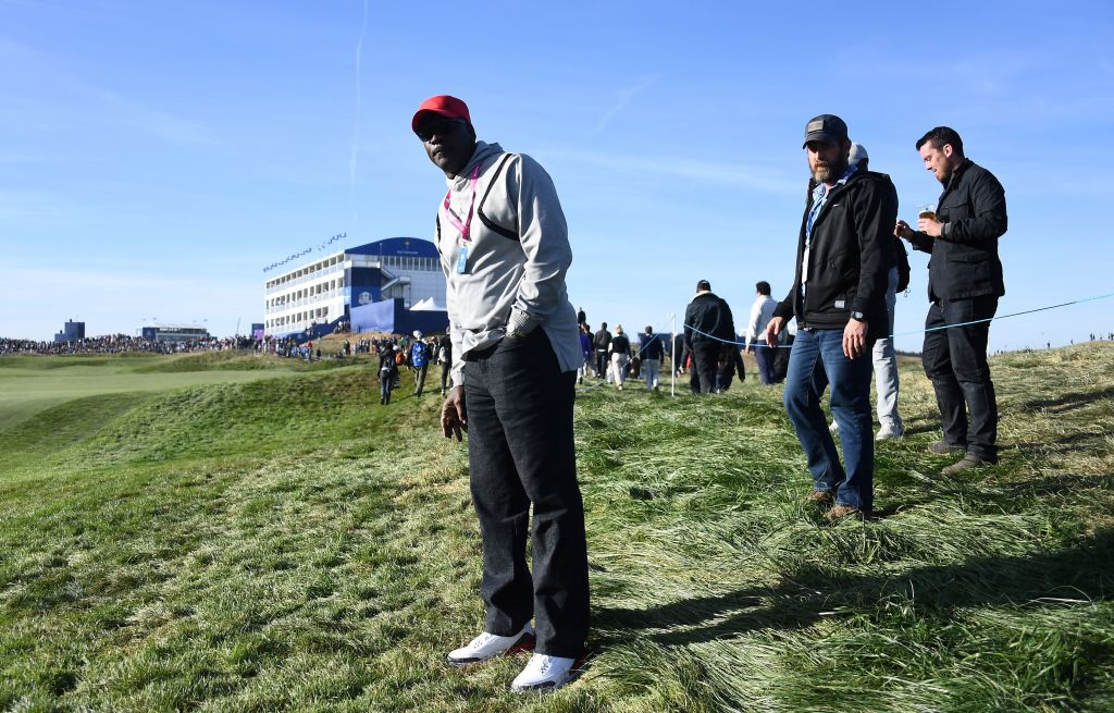 Former NBA player Michael Jordan watches Tiger Woods in 2018