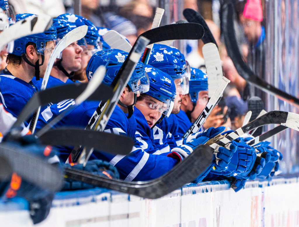 Mitch Marner of the Toronto Maple Leafs looks on from the bench