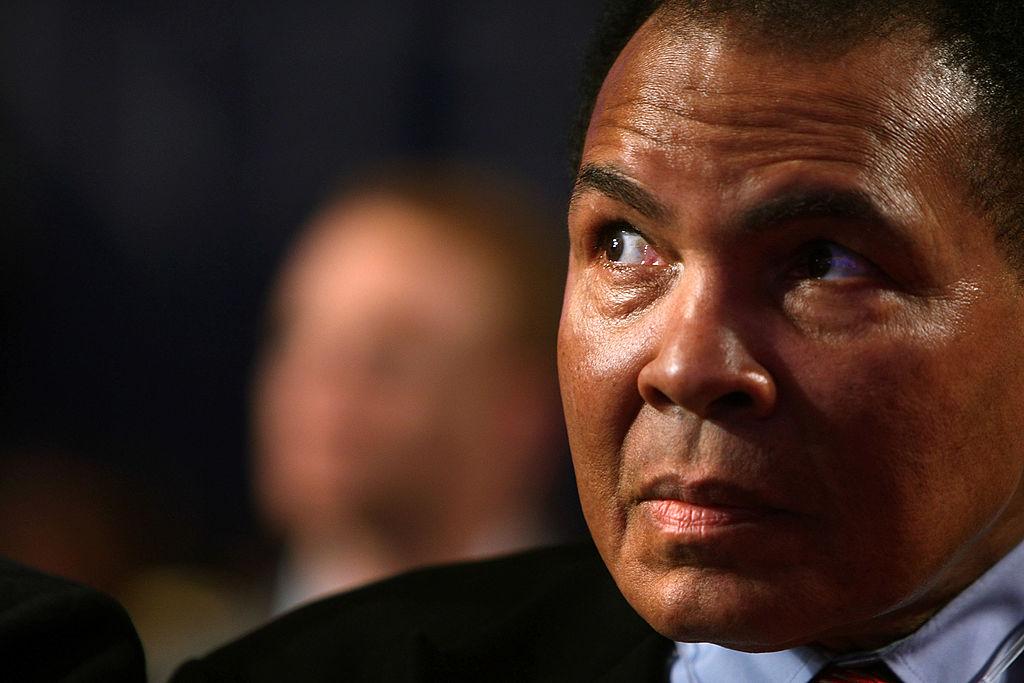 Muhammad Ali looking on at a global summit meeting
