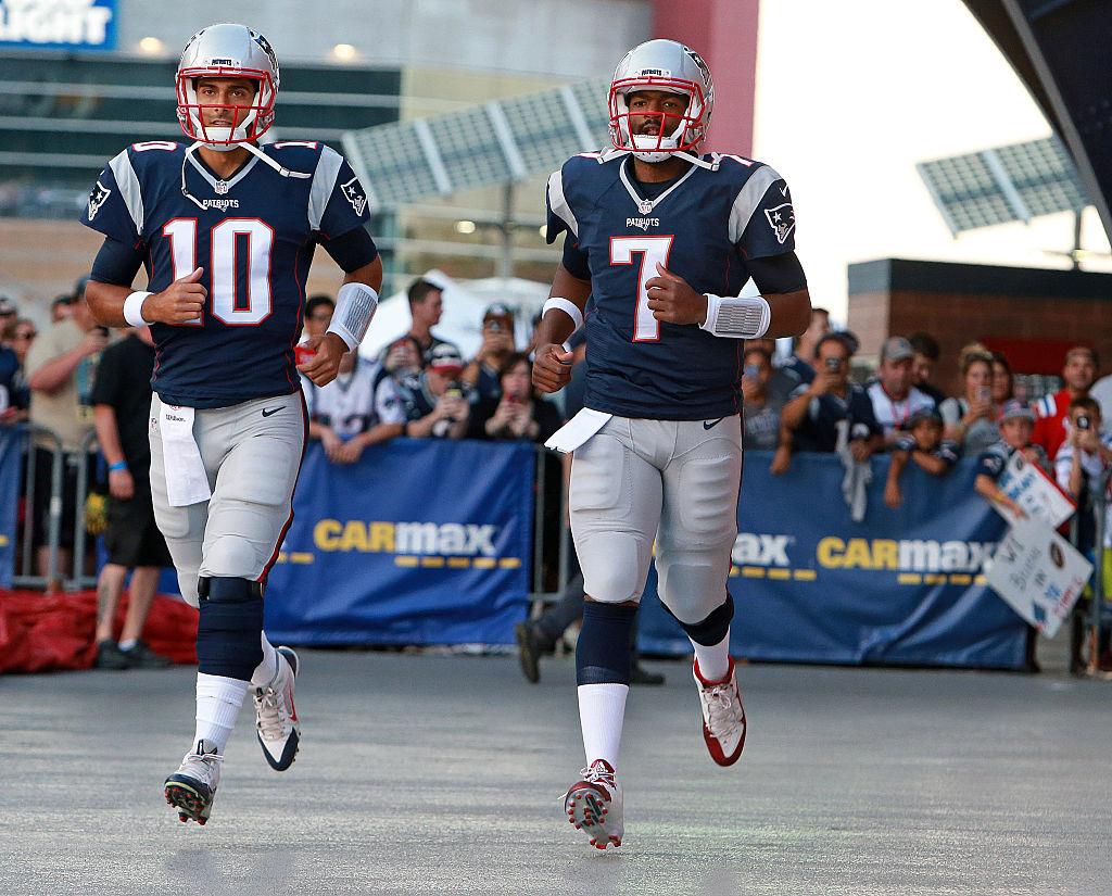 Patriots quarterback Jimmy Garopollo and Jacoby Brisett run out for pregame warm-ups in 2016
