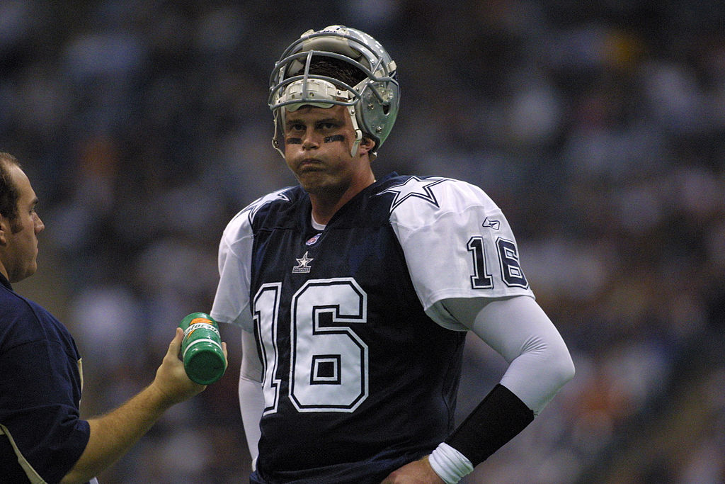Quarterback Ryan Leaf of the Dallas Cowboys rests on the sideline