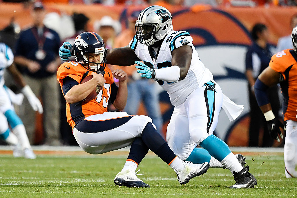 Quarterback Trevor Siemian of the Denver Broncos is tackled by defensive tackle Vernon Butler of the Carolina Panthers in 2016