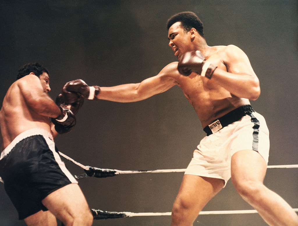 Heavyweight champions Muhammad Ali and Rocky Marciano boxing in composited film