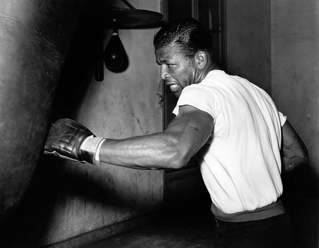 Sugar Ray Robinson hitting a punching bag