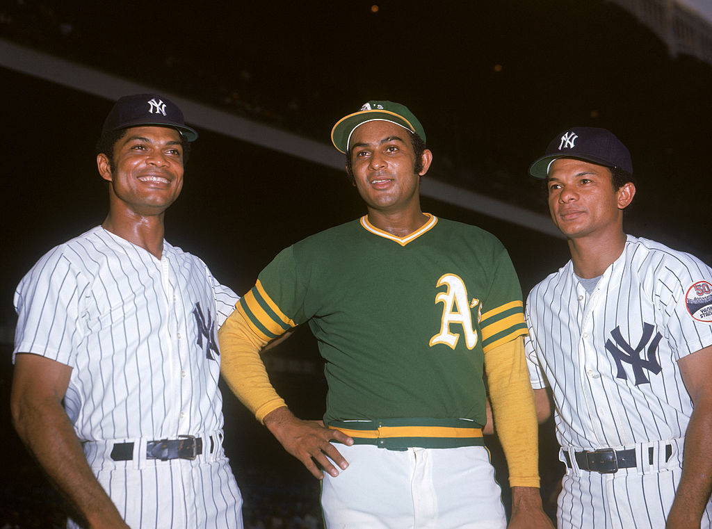 The Alou brothers (L-R) Felipe Alou of the New York Yankees, Jesus Alou of the Oakland Athletics, and Matty Alou of the Yankees in 1973