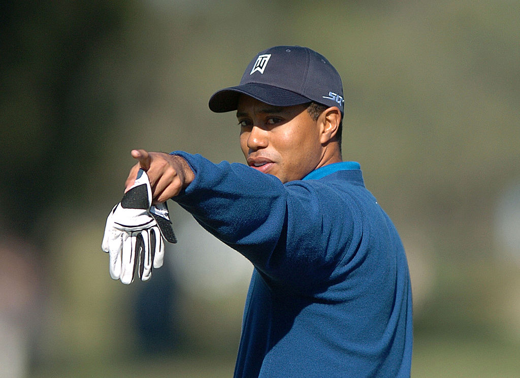 Tiger Woods pointing towards the camera during a golf tournament