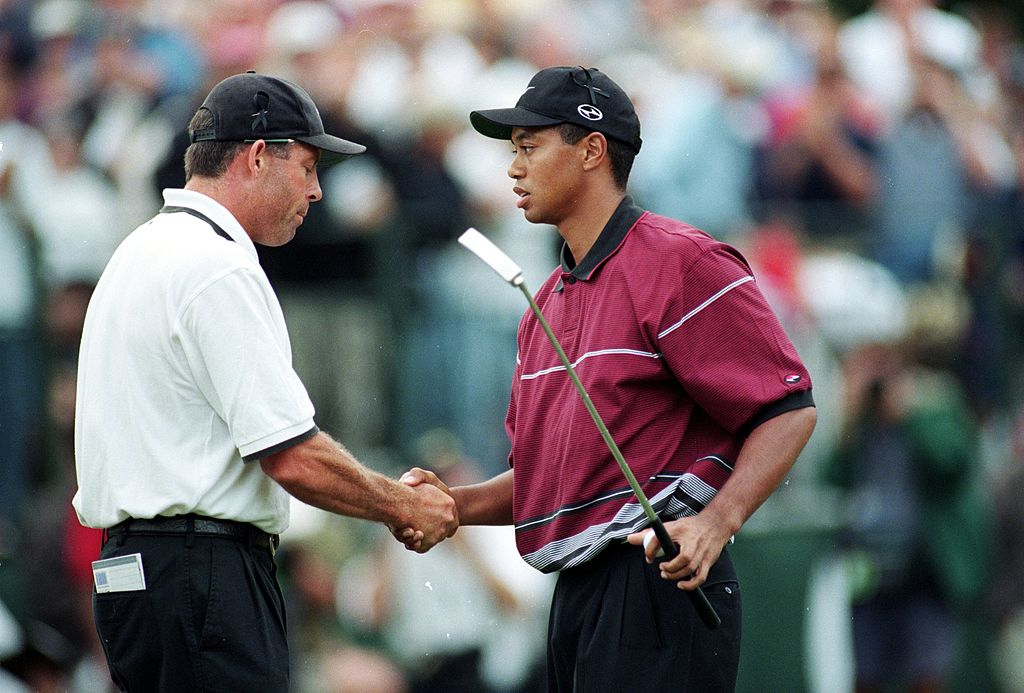Tiger Woods shakes hands with Steve Williams during The Tour Championship in 1999