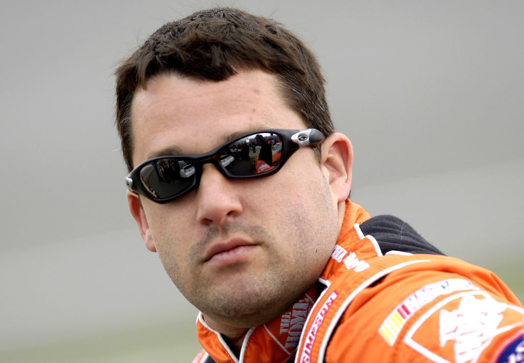 Tony Stewart looking on before a NASCAR race