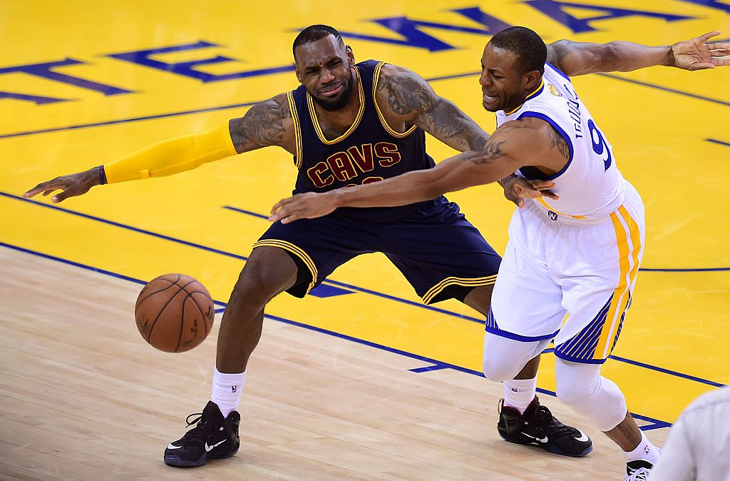 Andre Iguodala of the Golden State Warriors vies for the ball with LeBron James of the Cleveland Cavaliers