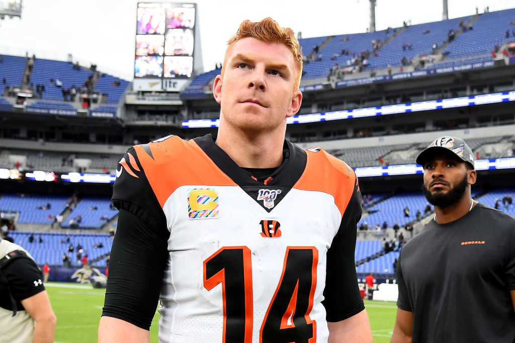 Andy Dalton walking off the field after playing the Ravens