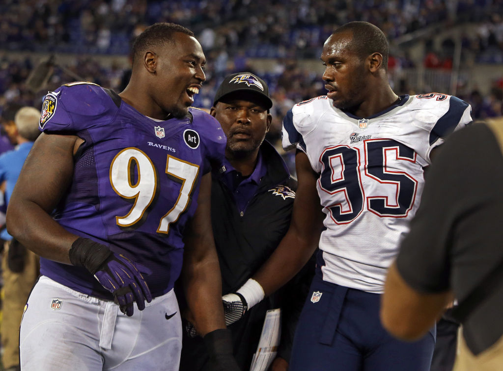 Ravens defensive lineman Arthur Jones (L) shakes hands with his younger brother, Patriots rookie defensive lineman Chandler Jones