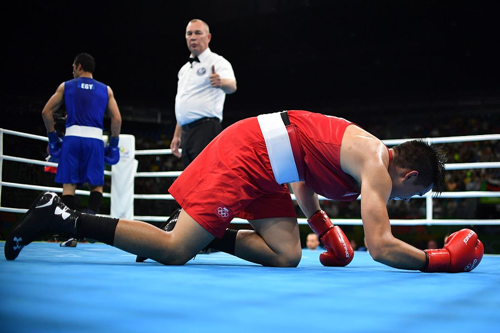 A boxer on his knees after being knockout during a match