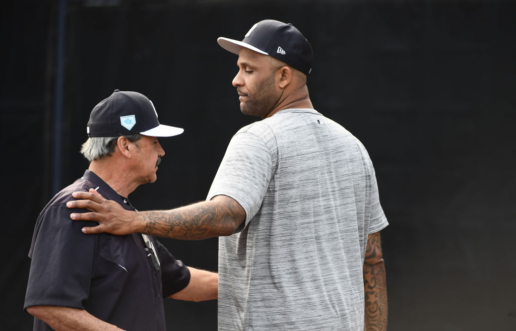 Yankees pitcher C.C. Sabathia speaks with instructor Ron Guidry in 2019