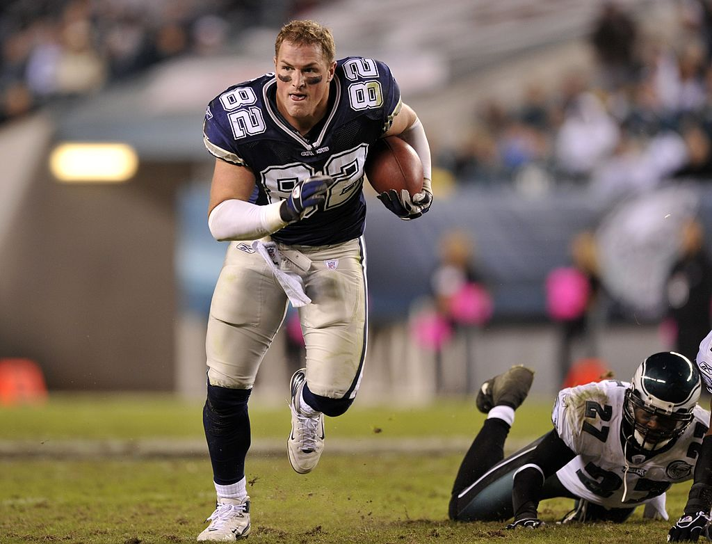Jason Witten running with the ball without his helmet on