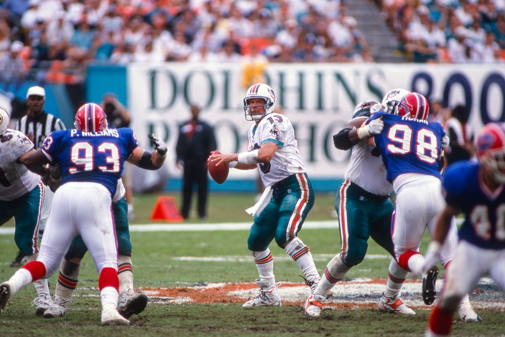 Dan Marino of the Miami Dolphins looks to pass in 1999