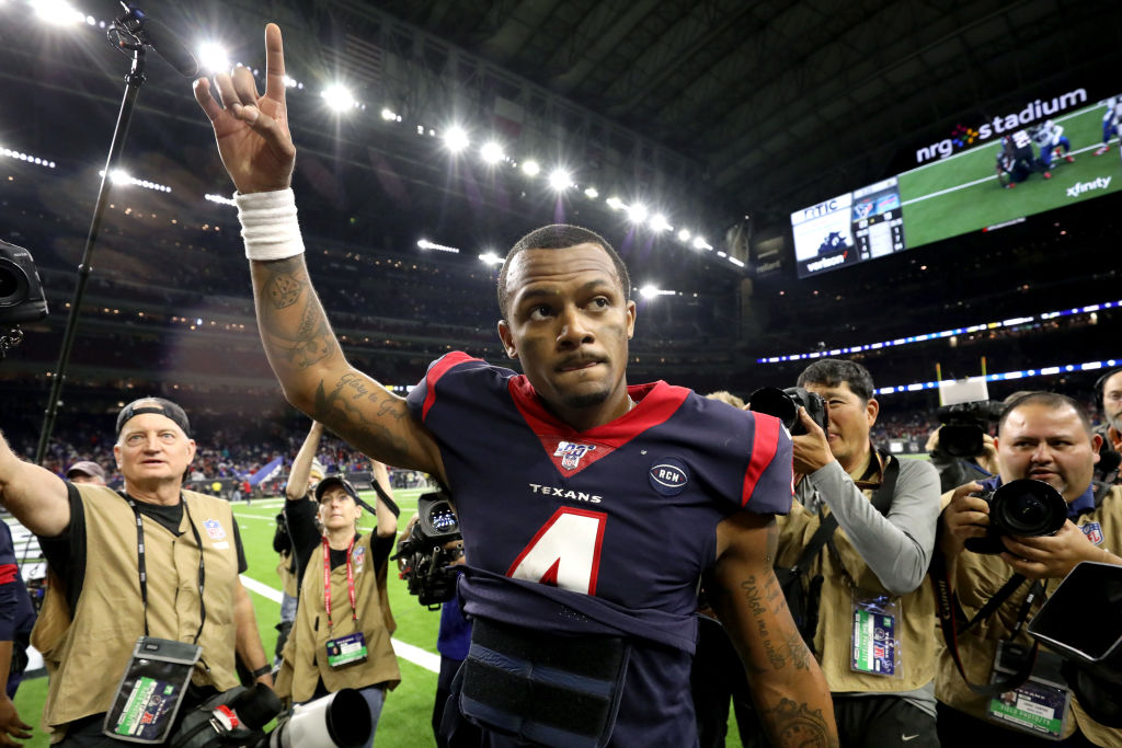 Deshaun Watson walking off the field after winning a game